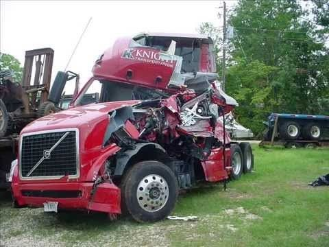 trucking accident crash red Knight truck with a smashed cab