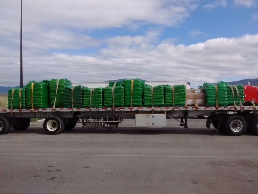 flatbed trailer loaded with fertilizer going from the Scott's plant in Marysville, WA to Home Depot in Great Falls, MT