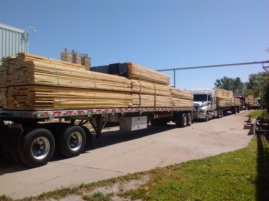 flatbed loaded with Lumber from Bennett Lumber in Princeton, ID being delivering to Pella Windows & Doors in Pella, IA