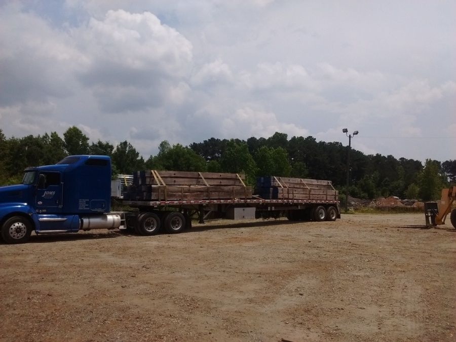 flatbed trailer loaded with crane mats delivering to construction site in Oregon OH