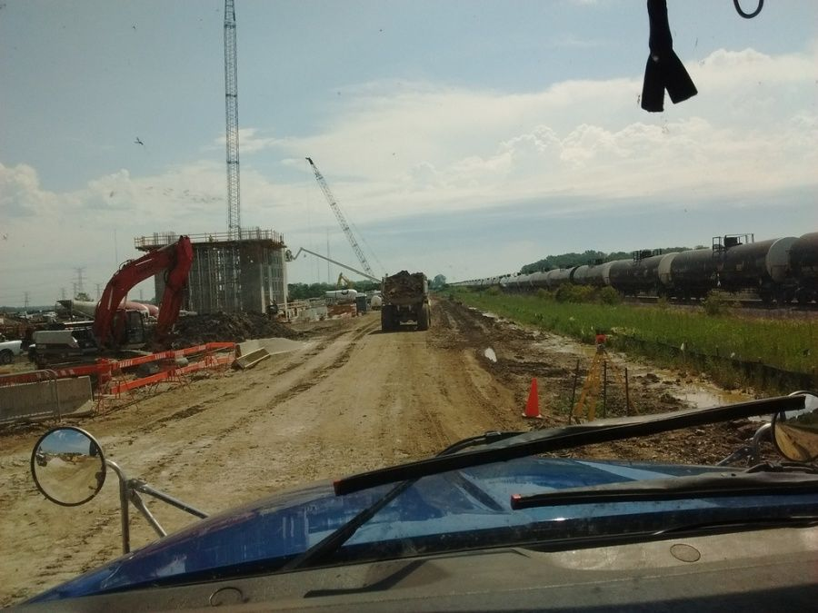 view through the windshield flatbed trailer loaded with crane mats delivering to construction site in Oregon OH