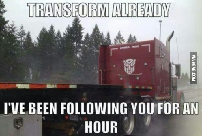 funny trucking pictures red flatbed truck with transformers image painted on it