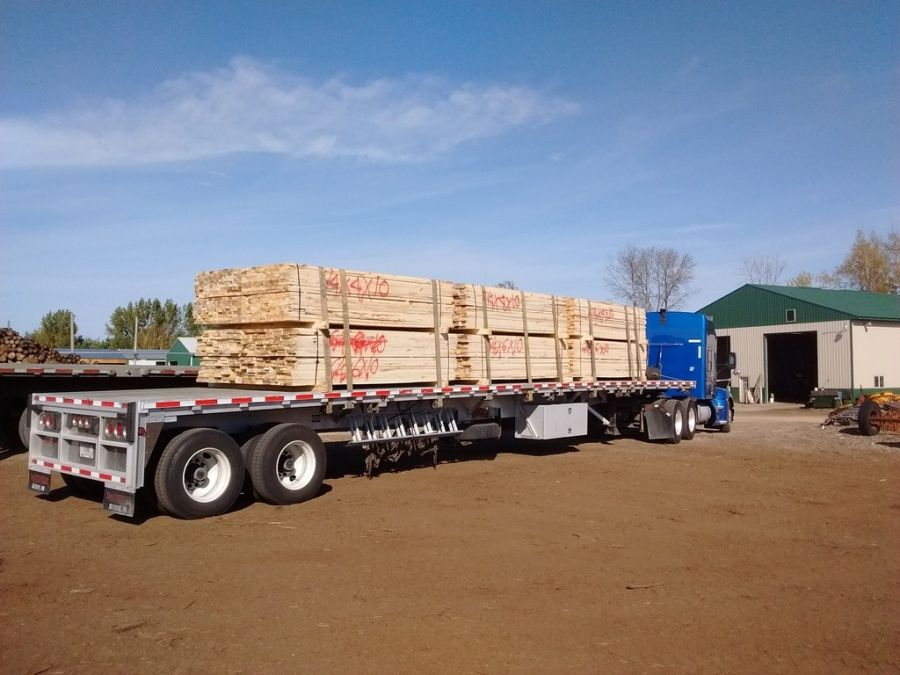 lumber for making pallets loaded on flatbed trailer