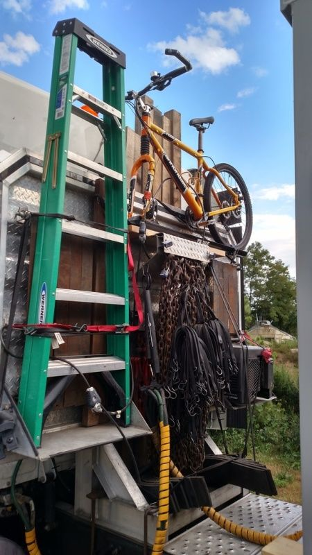truck drivers flatbed securement equipment stepladder bicycle strapped to back of truck