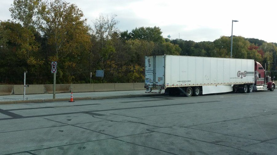 trucker parked behind a no-parking sign on the pennsylvania turnpike