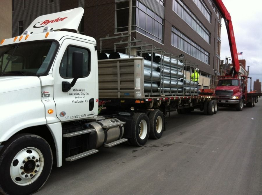 ryder staked flatbed loaded with aluminum pipe