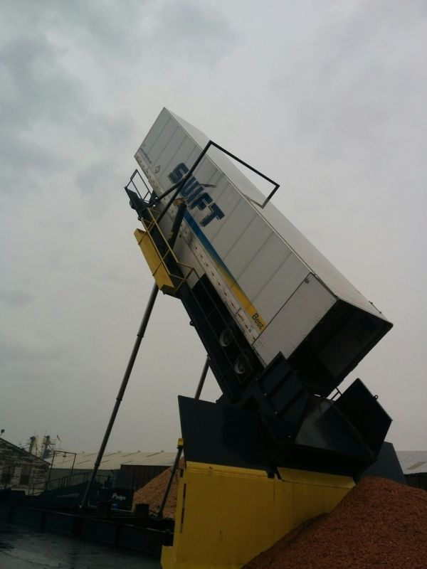 trailer tipper unloading redwood chips from a Swift trailer