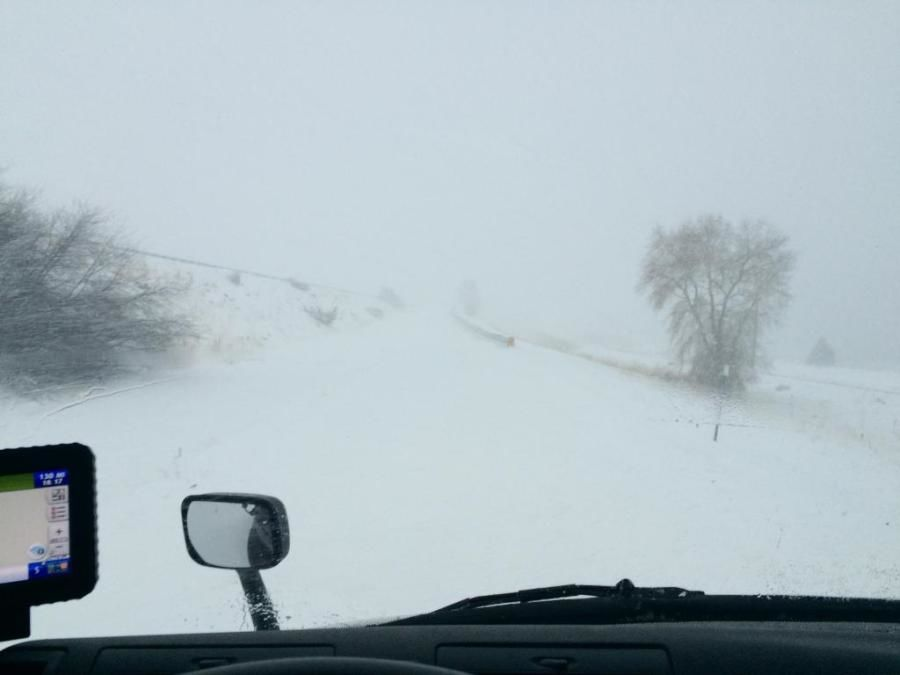 truckers picture of snow-covered road in storm