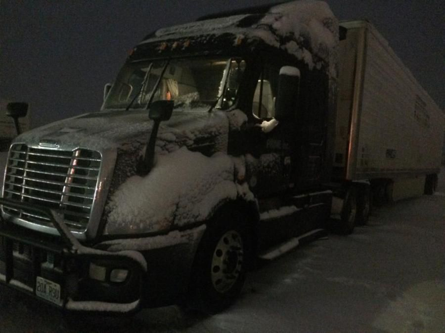 tractor trailer covered in snow