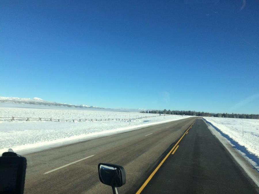 trucker's picture of beautiful snow-covered mountain field and road scenery