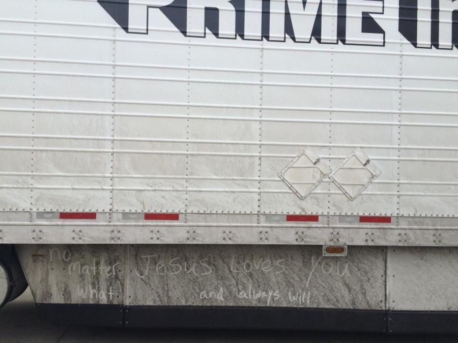 trailer skirt graffiti in the dirt on a Prime truck