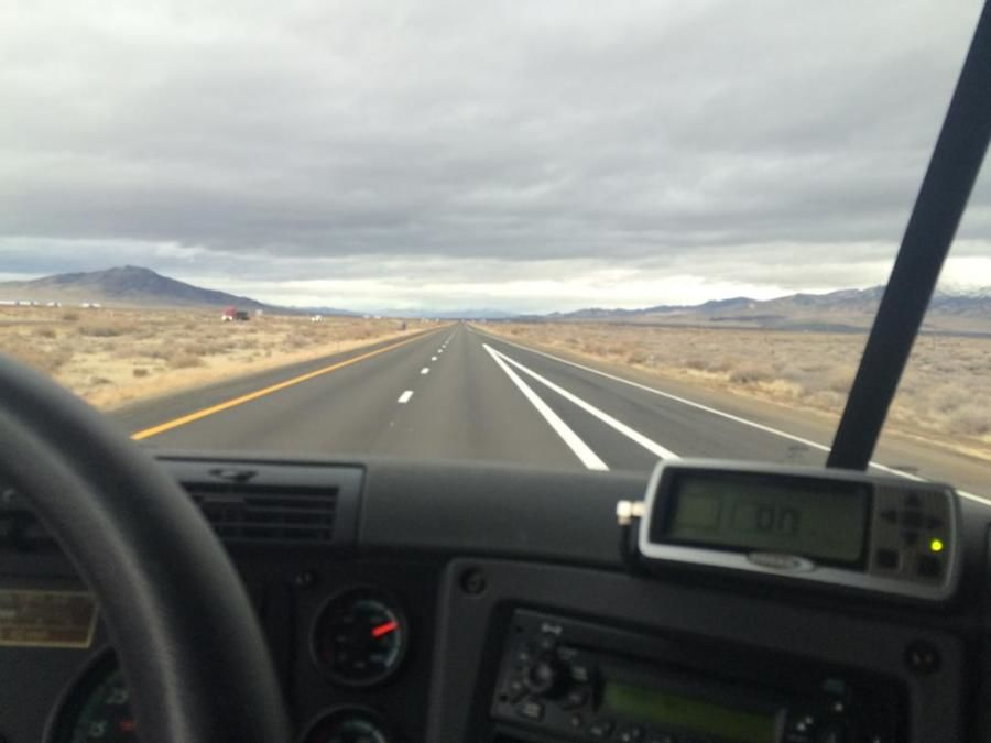 beautiful picture of mountain scenery taken by truck driver through the windshield