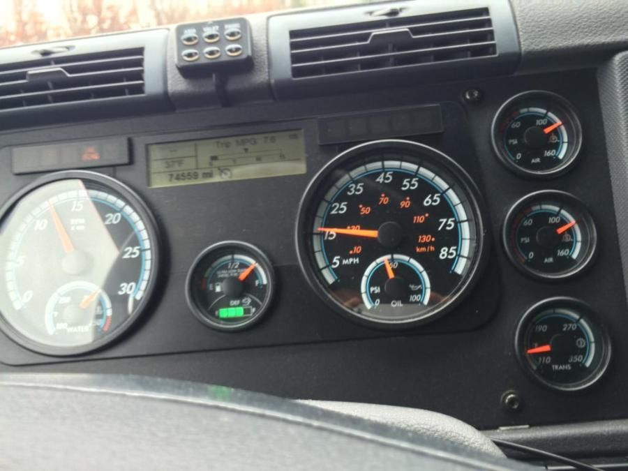 picture of truck drivers dashboard and speedometer