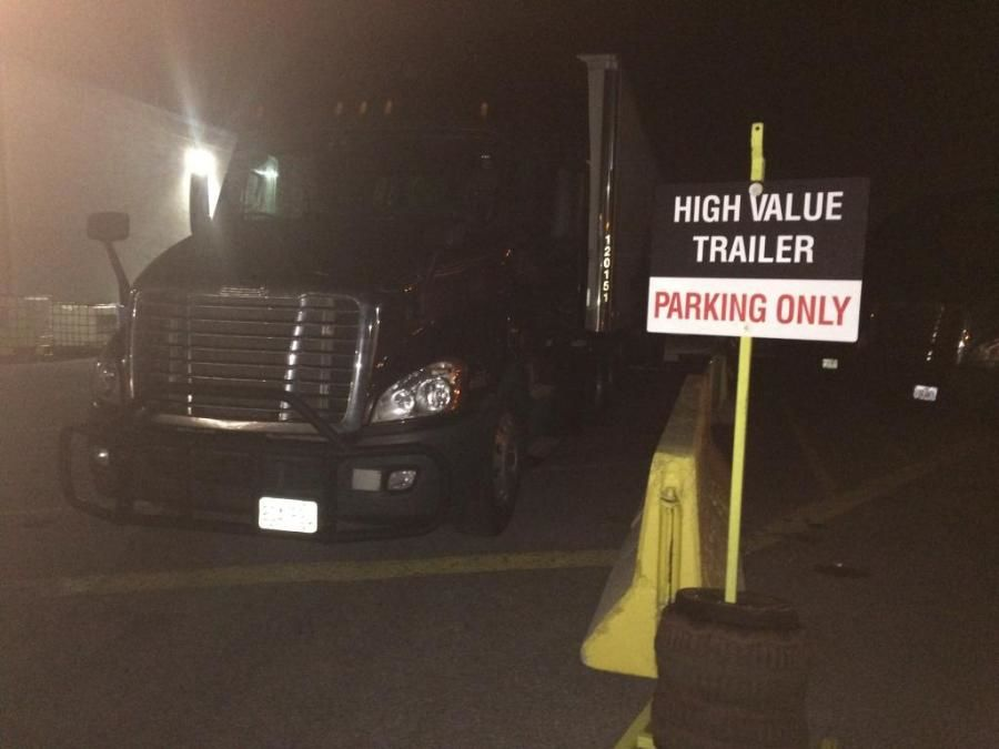 Prime truck parked in front of high value trailer parking sign at night