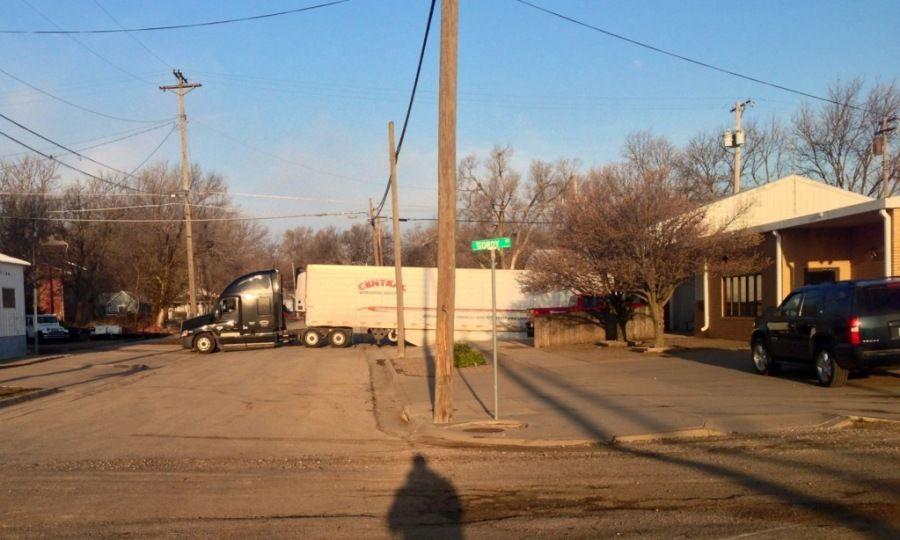 tractor trailer delivering parked blocking street