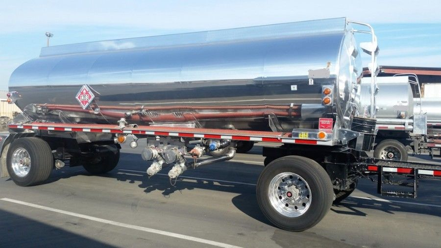shiny chrome tanker truck pulling 2-axle tank trailer