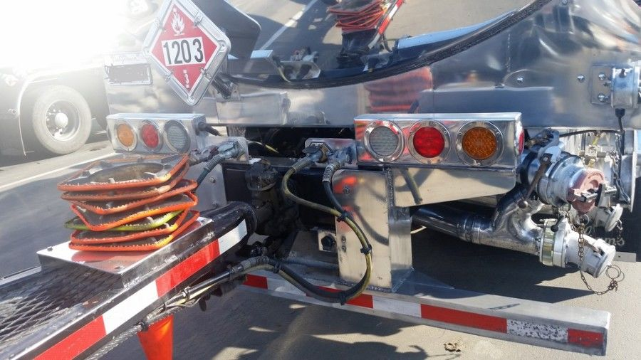 back of chrome hazmat tanker truck
