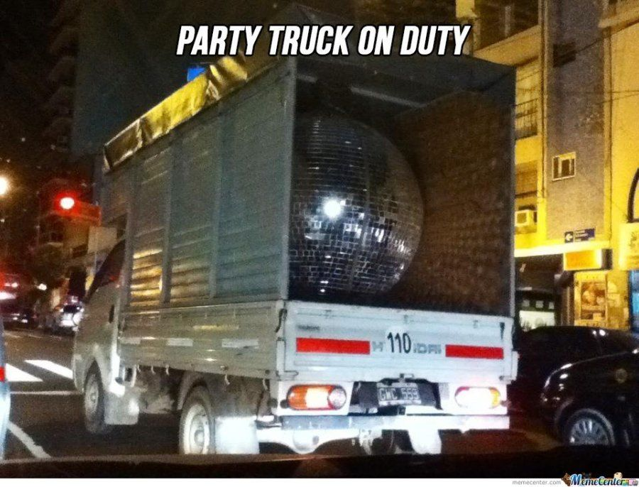 funny trucking picture box van carrying giant shiny disco ball