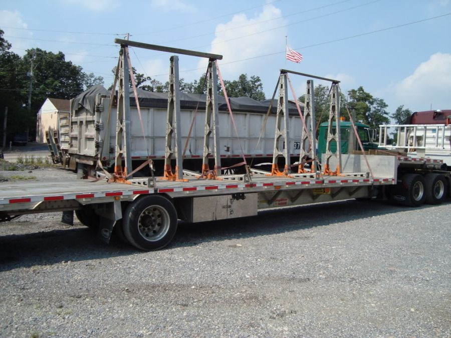 flatbed trailer with racks used to haul glass