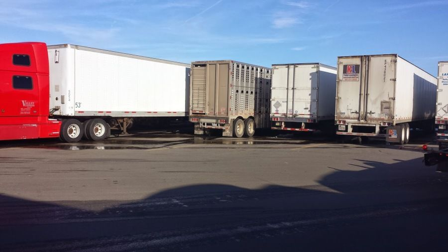 trucking trailer wedged into a really tight spot at a truck-stop