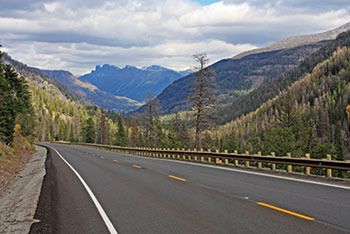 trucking picture of the open road and beautiful mountains