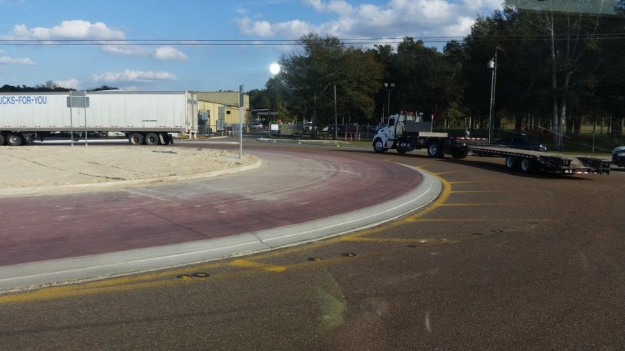 flatbed truck going through a roundabout in Hammond LA