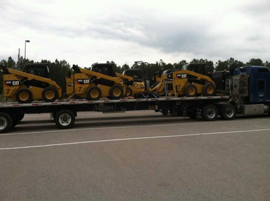 CAT forklifts loaded on flatbed trailer