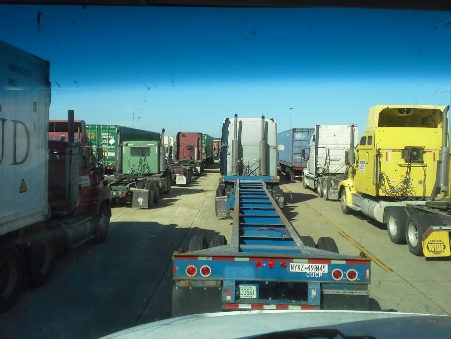 truck driver waiting in long line to get loaded at Union Pacific in Joliet, IL