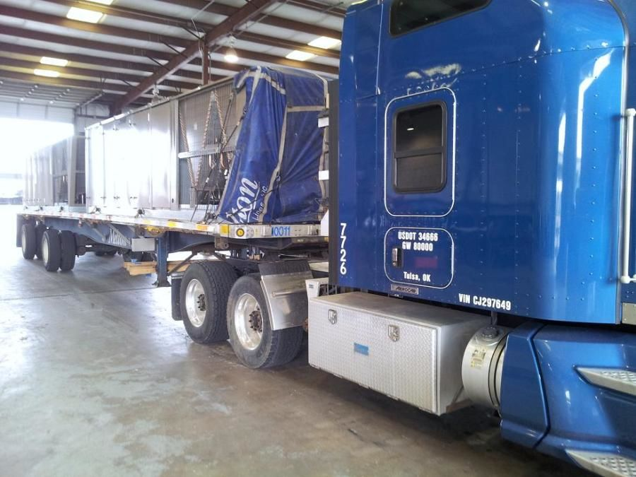 Melton flatbed loaded with air conditioning units