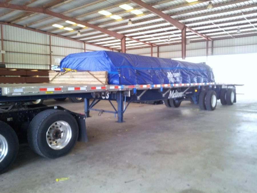 Melton loaded tarped and strapped flatbed trailer