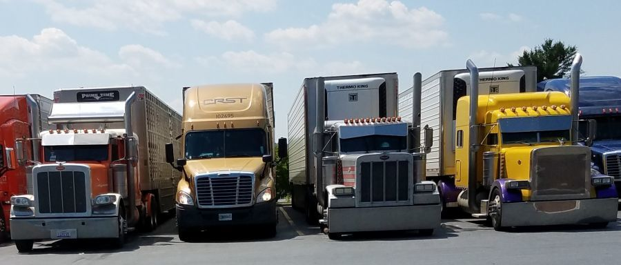 trucks lined up in a truck stop