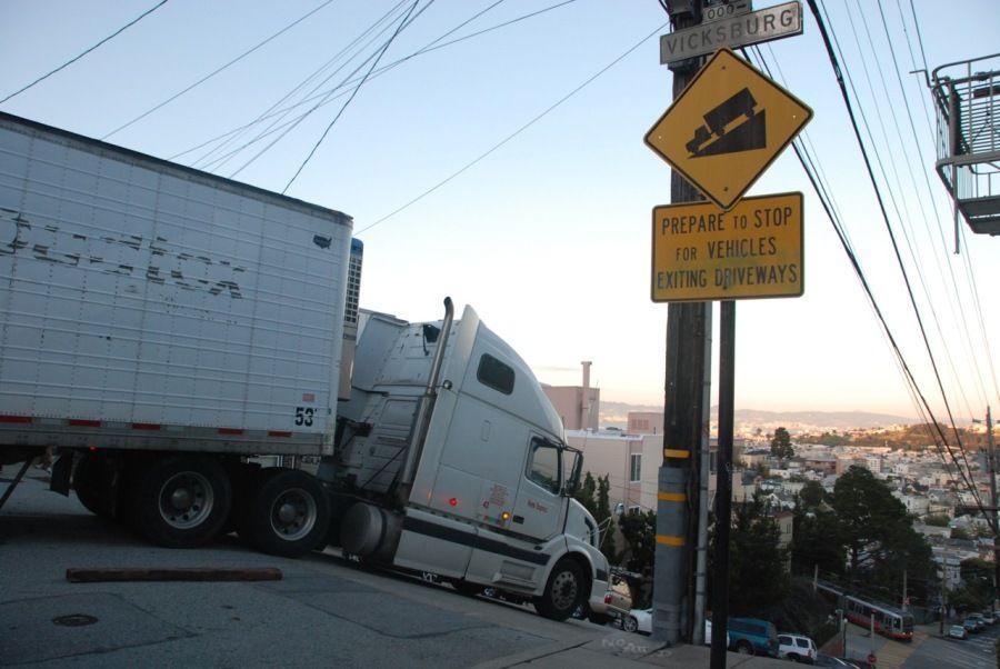 semi truck stuck on hill side