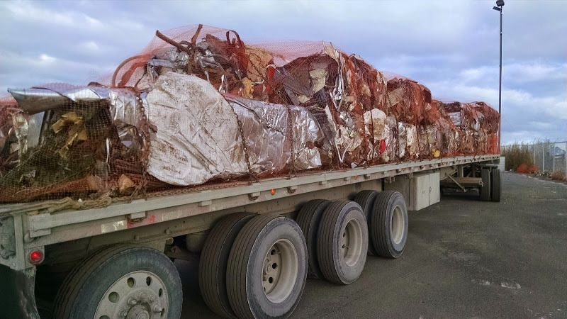 flatbed loaded with scrap metal