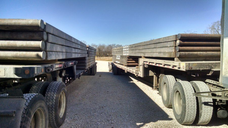 flatbed trailers loaded with steel