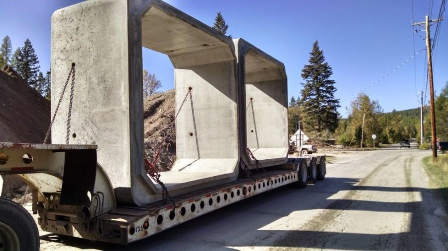 flatbed loaded with cement bridge pieces