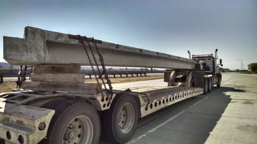 flatbed trailer loaded with bridge beam