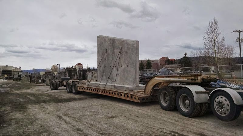 cement wall loaded on flatbed trailer
