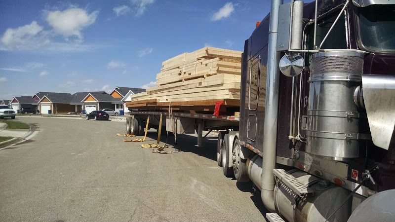flatbed trailer loaded with prefab walls