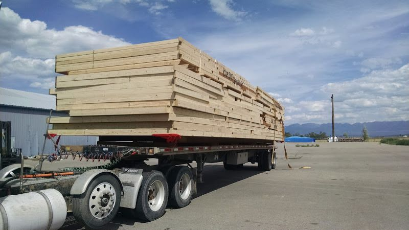 flatbed trailer loaded hauling prefab wooden walls