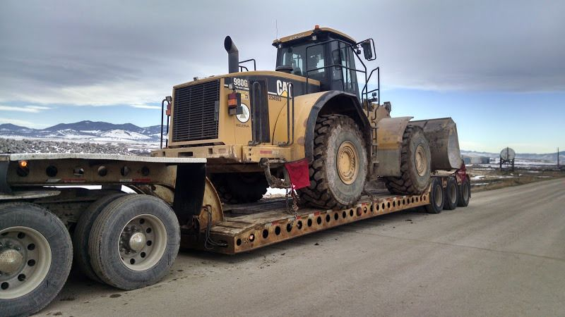 980 CAT loader loaded on flatbed trailer