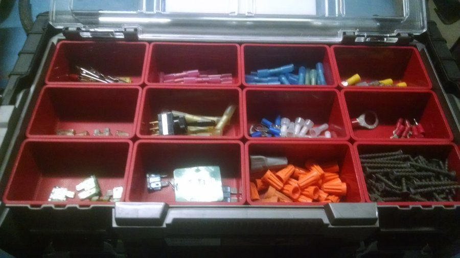 truck driver's plastic organizer for spare fuses lights parts