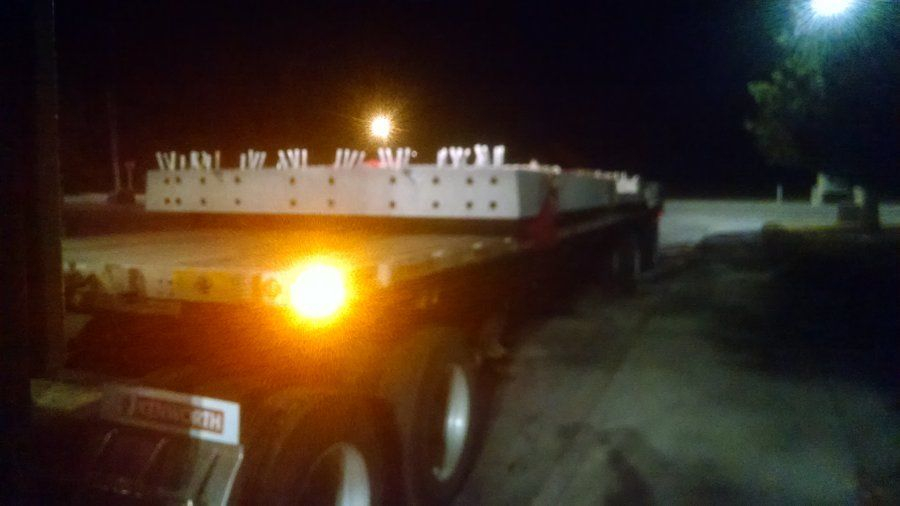 back of loaded flatbed trailer at night