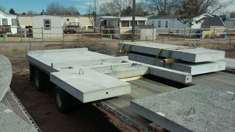 flatbed trailer loaded with concrete cement slabs