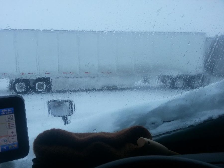 truck drivers view out the window in a snowstorm
