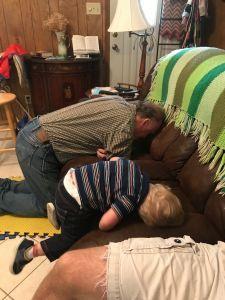 Grandson aping his grandpa.