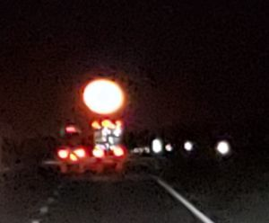 Two trucks Under the Moon
